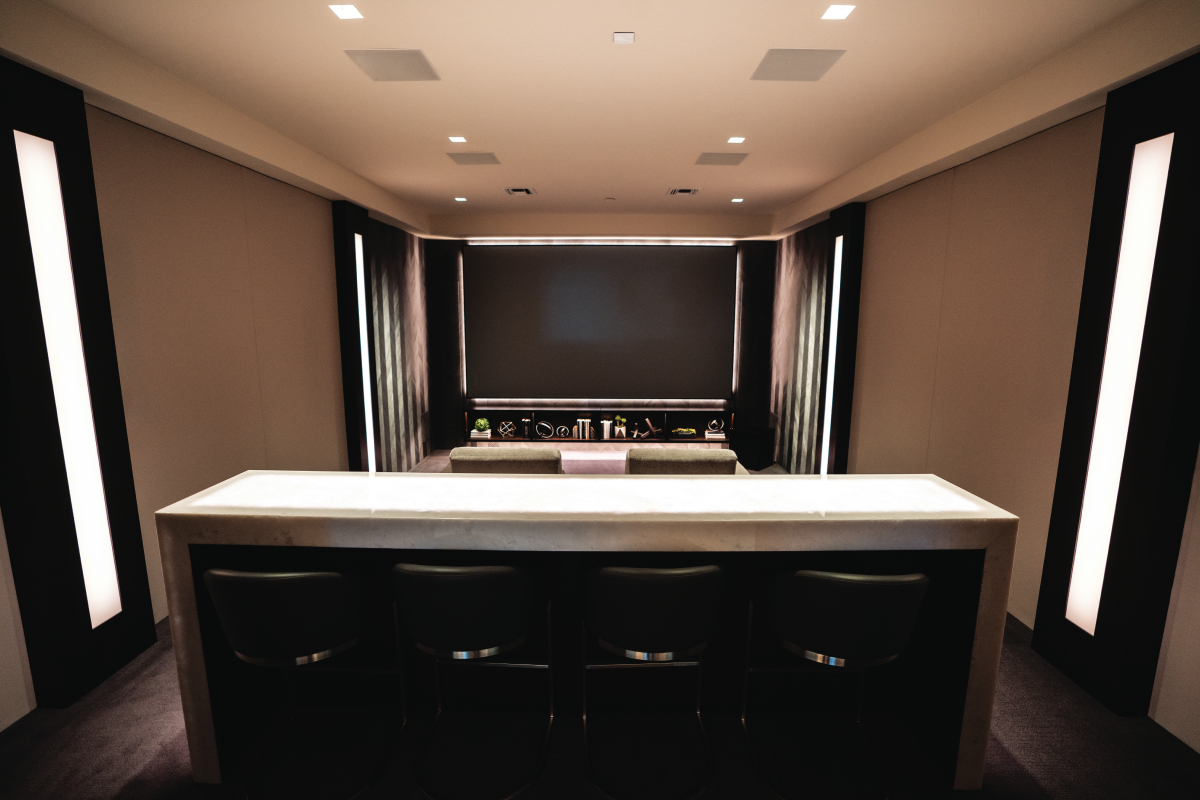 Home theater system with in-wall speakers